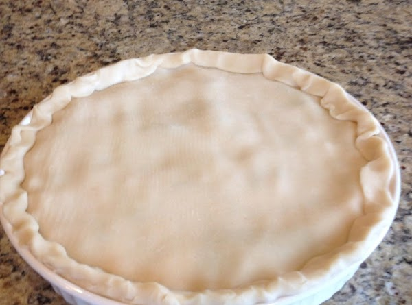 In a deep pie plate, lay one pie crust to line bottom of plate....