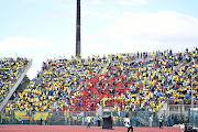Supporters sing and dance during the CAF Champions League match between Mamelodi Sundowns and Al Ahly at Lucas Moripe Stadium on April 06, 2019 in Pretoria, South Africa.