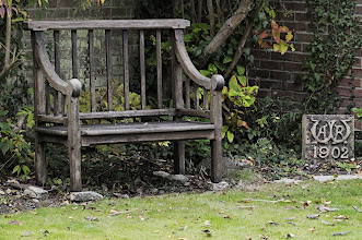 Photo: Wallace's garden bench and terracotta monogram from his house Old Orchard in Broadstone, Dorset. Property of the Wallace family. Copyright George Beccaloni