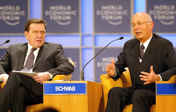 Photo: NEW YORK, 01FEB02 - Klaus Schwab (R), Founder and President of the World Economic Forum, talks on the podium while Gerhard Schroeder (L), Federal Chancellor of Germany, is listening during a session of the 32nd Annual Meeting of the World Economic Forum at the Waldorf-Astoria hoteat the Waldorf-Astoria hotel in New York on February, 1, 2002.