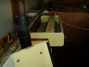 Photo: Bathroom medicine cabinet and vent behind toilet.