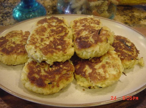 Fry the cakes in the vegetable oil in an electric skillet, medium-high heat, until...