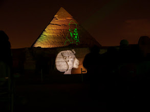 Photo: Image on wall, laser on pyramid, and the guy in the hoodie finally moved (he was totally motionless in the other exposures).