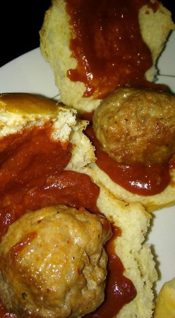 Put a meatball on each bun. Place on baking sheet.