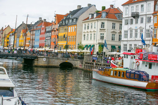 Nyhavn-copenhagen.jpg - Crowds throng through Nyhavn, the popular neighborhood that lines the canals of Copenhagen, Denmark.