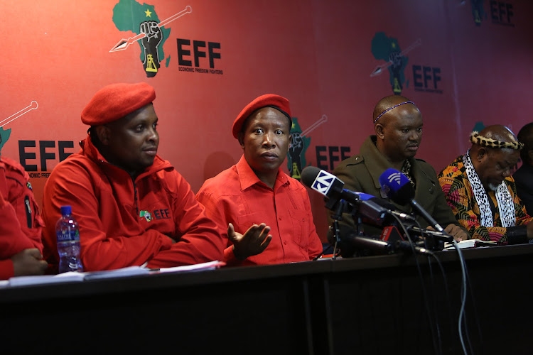 EFF leader Julius Malema and Zolani Mkhiva (CONTRALESA), brief the media in Braamfontein, Johannesburg. They spoke about Land redistribution without compensation. Also present were Floyd Shivambu (EFF) , Kgosi SetlamoragonThobejane (CONTRALESA) and various other members of the respective groups. Malema also spoke about EFF policy and announced that the party is joining forces with Contralesa.