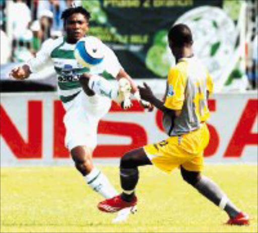 BATTLE: Bloemfontein Celtic's Didler Mbendje is challenged by Black Leopards' Thabiso Hlalele in thier Telkom Knockout match at Seisa Ramabodu Stadium in Bloemfontein yesterday. Pic. Sydney Mahlangu. 29/09/2007. Backpagepix