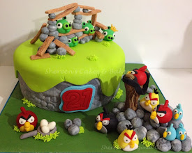 Photo: EDITOR'S CHOICE 2/17/2012  Angry Birds by Shereen's Cakes & Bakes  View cake details here: http://cakesdecor.com/cakes/7335 View all cakes by Shereen's Cakes: http://cakesdecor.com/ShereensCakes/cakes