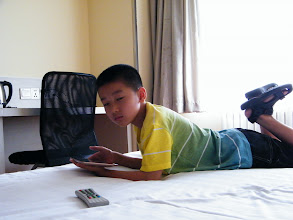 Photo: journey hometown in summer 2013 shakes doubts and plows hope: here warrenzh played video game on his new fonepad in hotel near railway station before next morning flight.