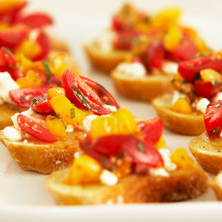 Bruschetta with Roasted Garlic Butter, Cherry Tomatoes.