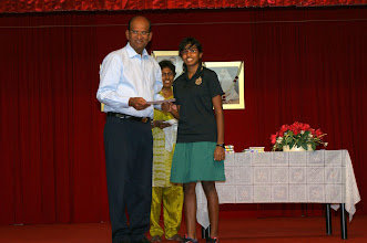 Photo: S. Aiswarya receiving the Excellence Award. She did well in O Level.
