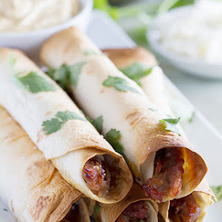 Slow Cooker Sweet Pork Baked Taquitos.