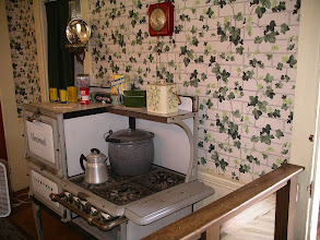 Photo: The stove that would have been in use in the 1940's Strawberry banke kitchen. We had the same wallpaper in the kitchen of a house my parents bought around 1960. The kitchen had been remodeled around 1950. Others have recognized this wallpaper from late 40's and 50's kitchens. It must have been popular.