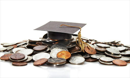 A picture of graduation cap on money Picture Credit: Thinkstock