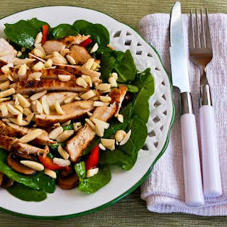 Asian Spinach Salad with Chicken, Mushrooms, Peppers, and Almonds.