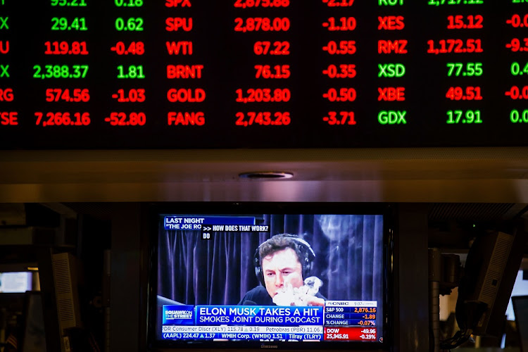 Telsa CEO Elon Musk is seen on a television screen on the floor of the NYSE in New York, the US, September 7 2018. Picture: BLOOMBERG