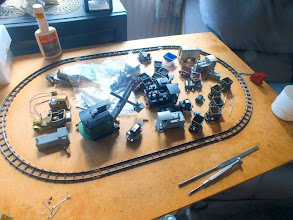 "Photo: 007 A glimpse of Rod Allcock's test track and some ""work in progress"" models – Rod is a busy (and highly skilled) modeller! ."