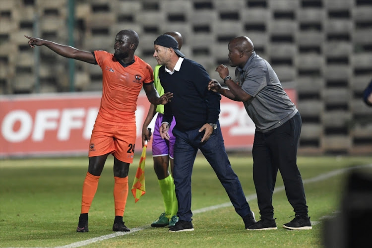 Polokwane City FC coach Jozef Vukusic is flanked by defender Simphiwe Hlongwane (L) and assistant coach Bernard Molekwa during the Absa Premiership match Bidvest Wits at Bidvest Stadium in Johannesburg on September 21, 2018.
