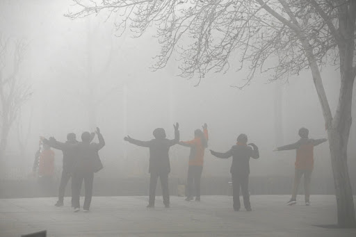 Carcinogenic:  People exercise in the smog on a polluted day in Zhengzhou, Henan province, China, on Monday January 9, 2017.  Picture: REUTERS