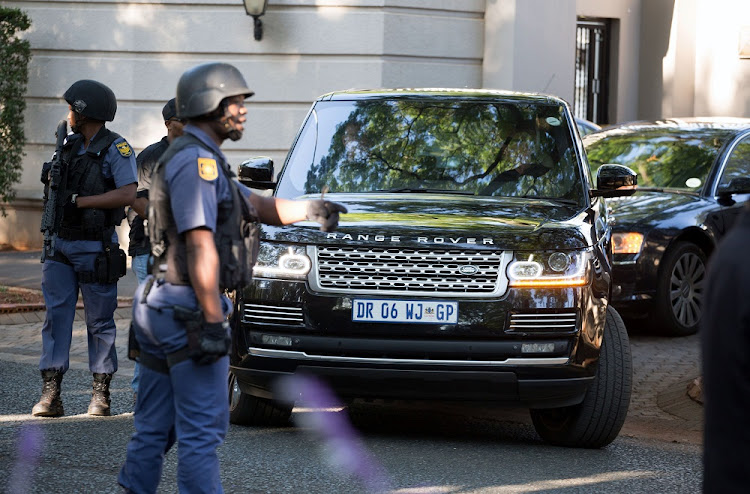 A police convoy leaves the home of the Gupta family in Johannesburg on February 14 2018. Picture: REUTERS