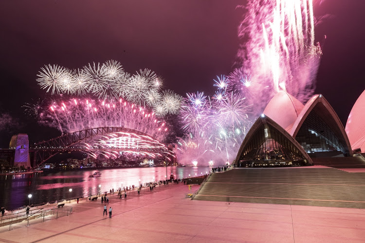 The Sydney Harbour fireworks display is seen over a near-empty Sydney Opera House forecourt during New Year's Eve celebrations on January 01, 2021 in Sydney, Australia.