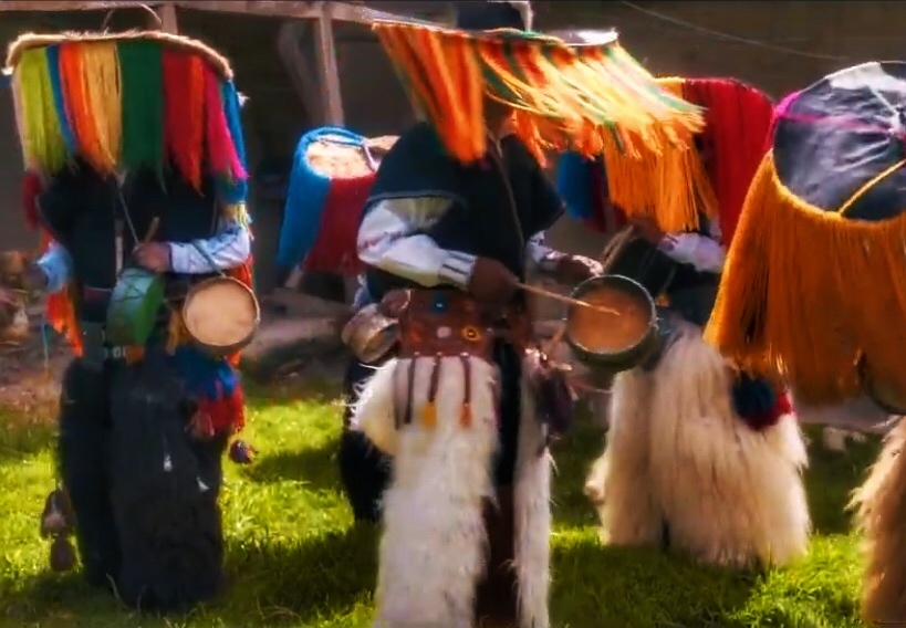 Group of Cañari carnavaleros playing small drums and doing a traditional carnival dance.