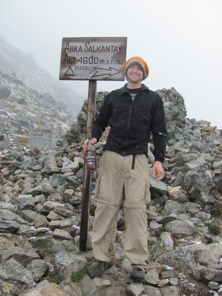 Photo: Our peak altitude, 4,600 meters above sea level.  At the Salkantay Pass.  It was snowing!  A very odd occurance in the dry season.  We of course celebrated reaching the peak with rum.