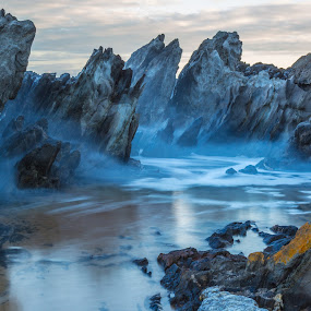 Mist between the rocks by Nicole Rix - Landscapes Waterscapes ( clouds, waterscape, beach, rock formation, rocks, mist,  )