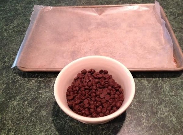 Line jelly roll pan with parchment or wax paper.  Put chocolate chips in...