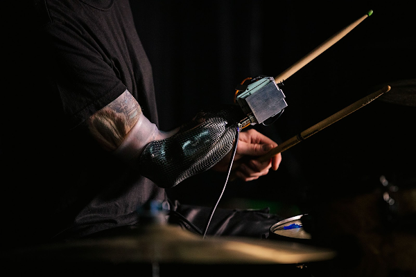 A closeup of Jason's prosthetic arm as he plays the drums.