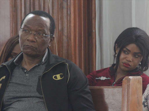 Former NYS Director general Richard Ndubai and Anne Ngirita follow proceedings at a Milimani court on Thursday, November 22, 2018 during the hearing of the NYS II CASE. /COLLINS KWEYU