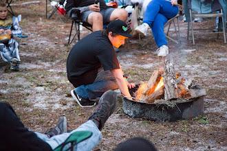 Photo: Trey tending the fire