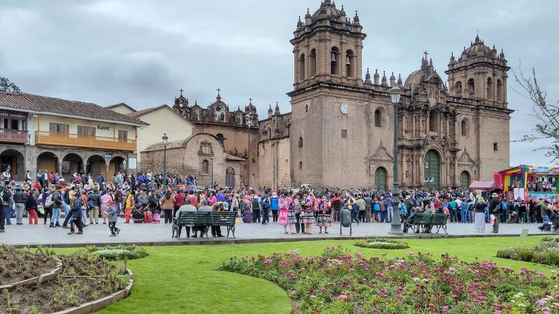 carnival+at+cusco+plaza+de+armas+cusco+central+square+cuzco+colonial+cusco+cathedral+Cathedral +Basilica+Assumption+virgin+church+compania+de+jesus+cusco+peru+south+america
