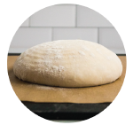 unbaked bread dough on a piece of parchment paper