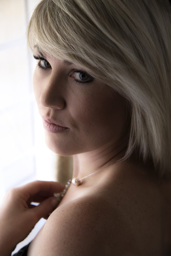Platinum Blond by Ruari Plint - People Portraits of Women ( natural light, dreamy, gentle, window, holding, platinum, blond, pretty, light, necklace,  )