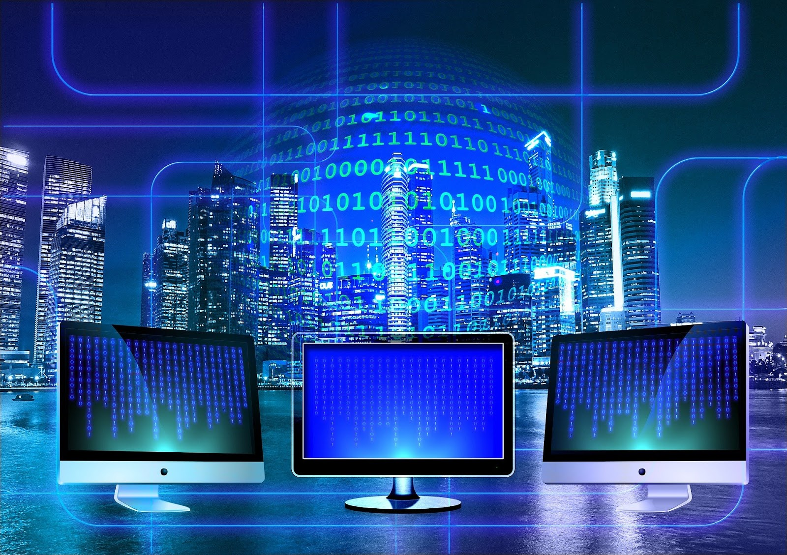 Three computer monitors sit on a desk in front of a window featuring a large city skyline at night. There is a holographic-like background image showing rows of coding.