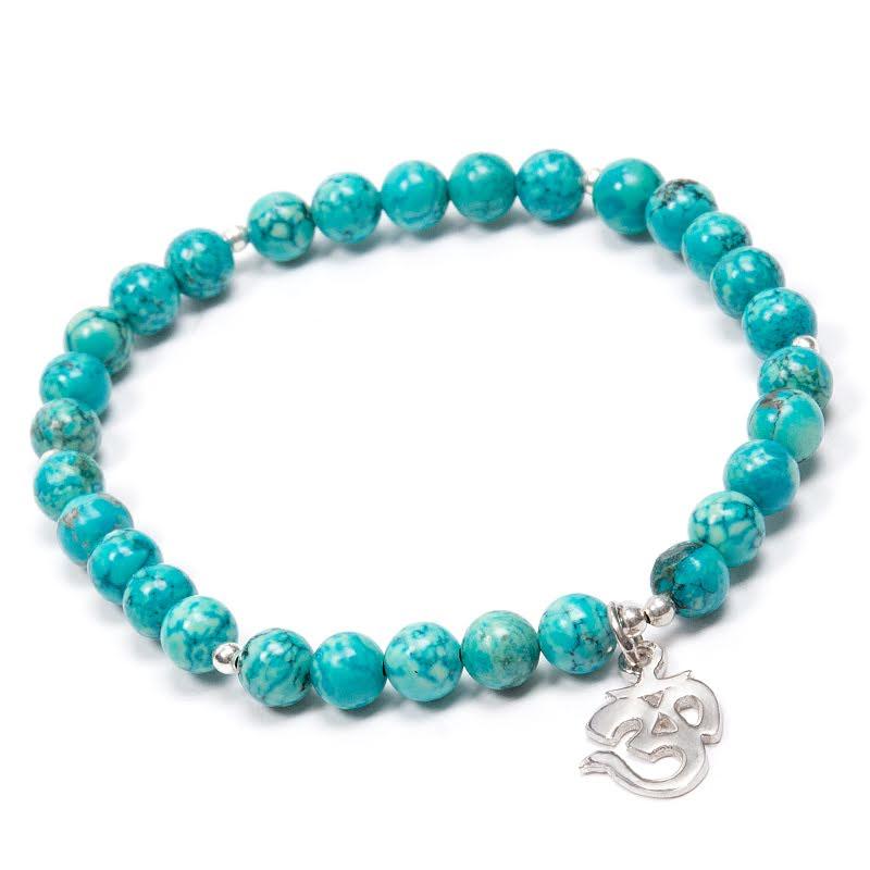 Turkos, armband med runda pärlor och Aum