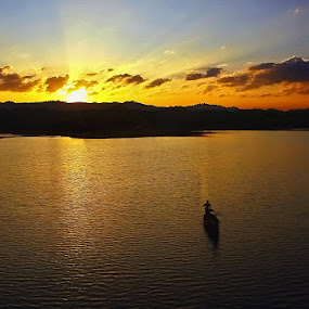 A lonely boat at the end of the day by Arafat Chowdhury - Landscapes Sunsets & Sunrises ( silhouette, a, at, lake, the, boat, of, sunset, sunrays, sunrise, day, lonely, end, river )