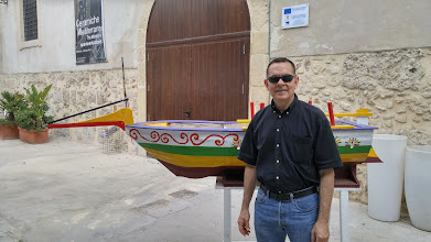 Photo: Me, in front of a papier-mache boat on the Ortygia beachfront