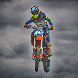 Flying Without Wings by Marco Bertamé - Sports & Fitness Motorsports ( clouds, speed, number, yellow, race, noise, jump, flying, red, motocross, blue, 245, air, high )