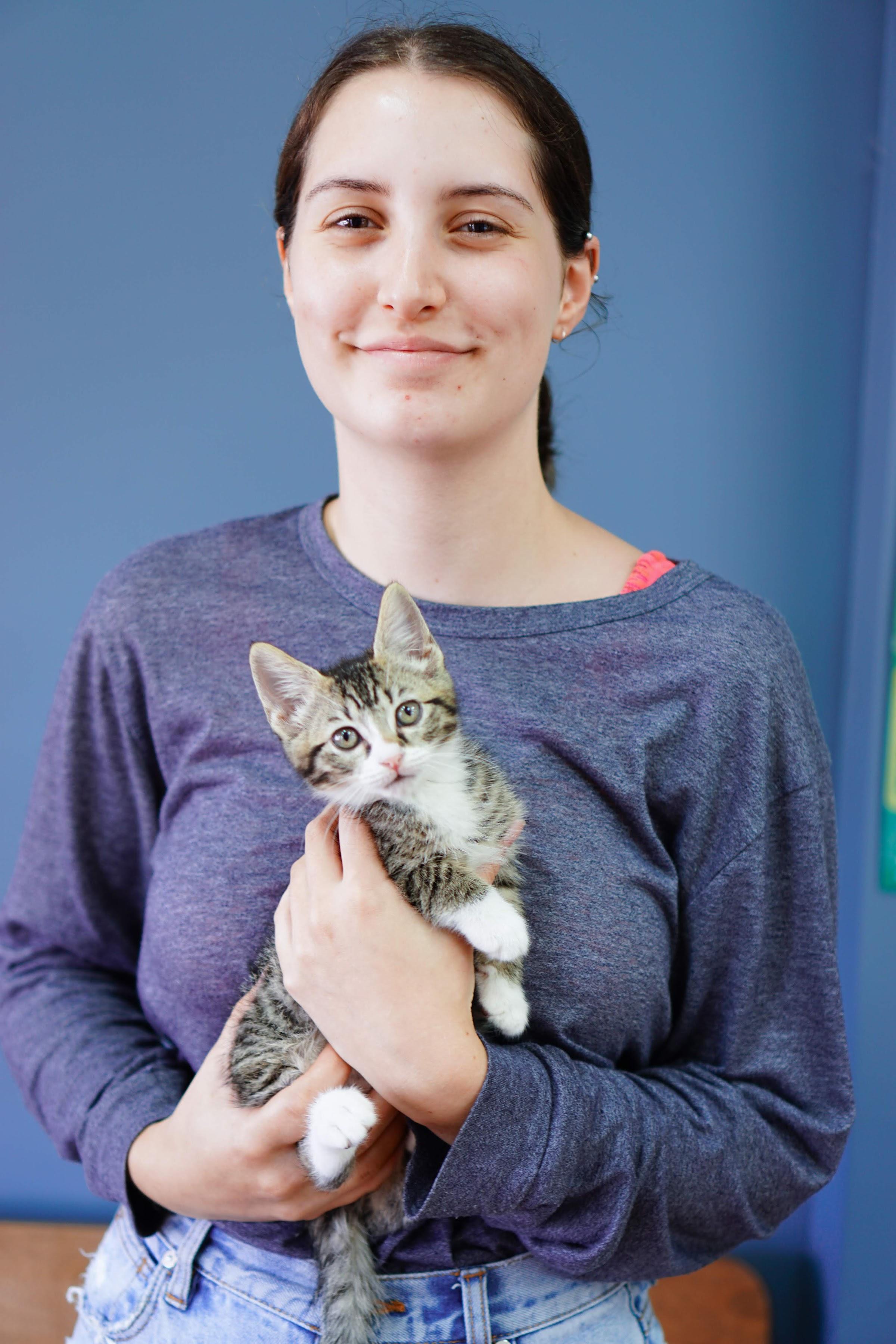 Vet nurse student Casey with cheeky tabby kitten