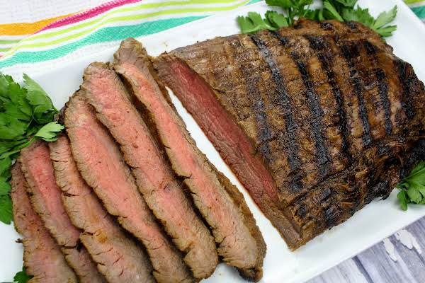 My Fav Marinated Flank Steak Sliced And On A Platter.