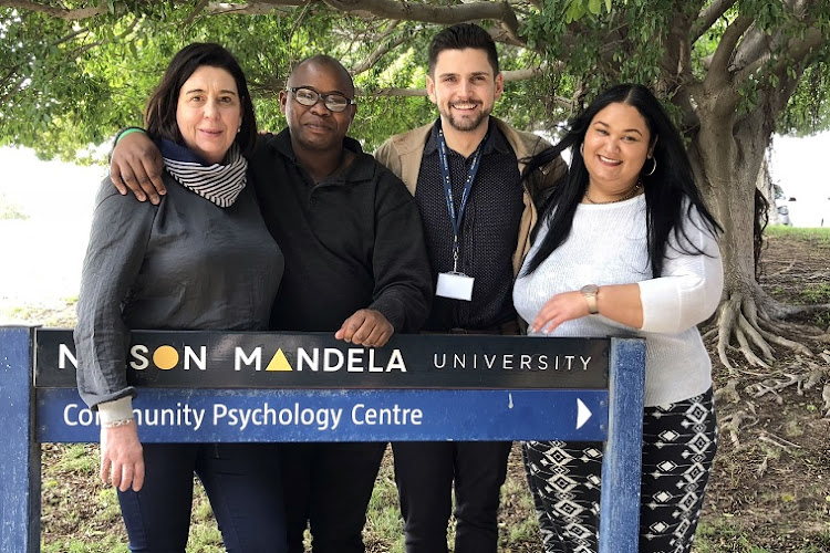 The Missionvale Community Psychology Centre's team, from left, Dr Jennifer Jansen with fellow academics Sihle Ntlangu, Terence Townsend and Lauren Maytham received an Engagement Excellence Team Award from Nelson Mandela University