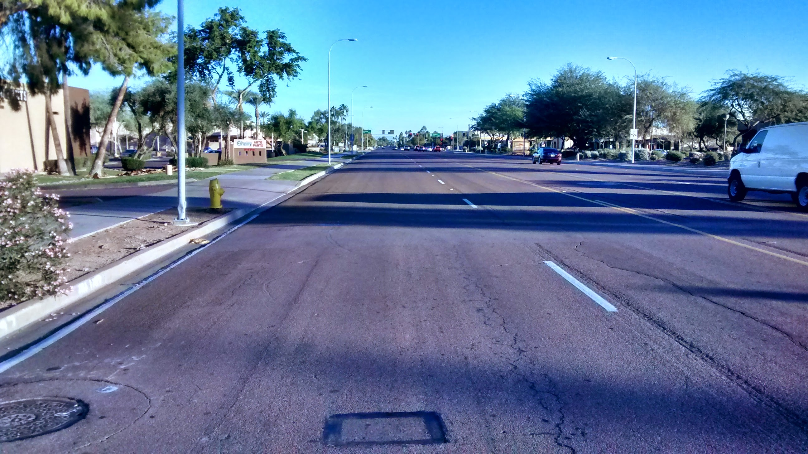 """Photo: Mcclintock Rd, Tempe. Southbound, facing north (can see intersection with Guadalupe Rd). This right lane is clearly """"wide"""" (perhaps 16 feet or more) but only for about 500' feet due to a """"lane drop"""" from 3 through lanes to two southbound."""