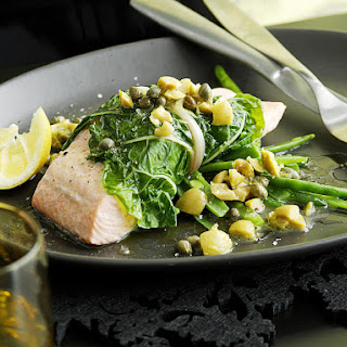Steamed Chard Wrapped Salmon with Lemon and Olive Sauce.