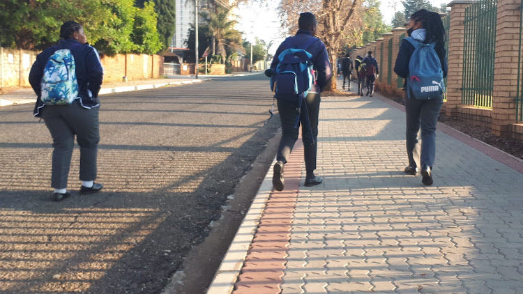 Pupils make their way to the school entrance at Sparrow Combined Technical School on Monday morning. After being away from school for more than two months, today marks the first official day back for the new term for grades 7 and 12.