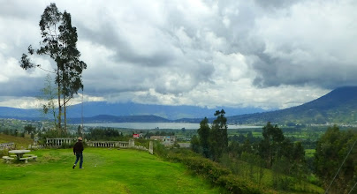 Photo: Roadside rest stop:  first glimpse of Lago San Pablo.  Otavalo is on far side of this lake.  Imambura volcano on the right.