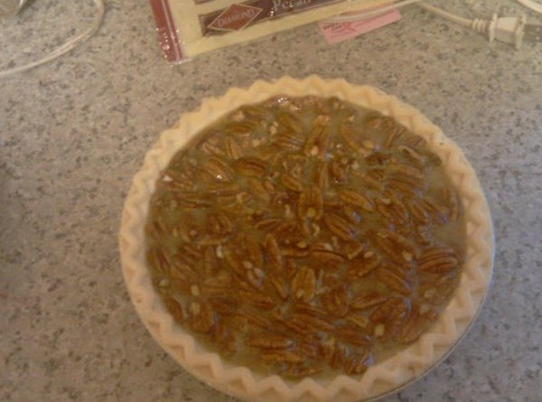 Pour mixture into the pie shell and place on a cookie sheet and bake...