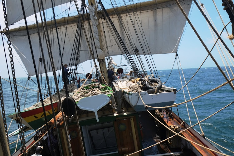 The sail-training vessel Picton Castle rolls along under full sail off the west coast of South Africa.
