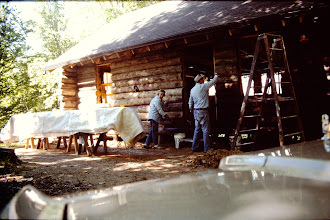 Photo: Staining the outside of the cabin. 1996
